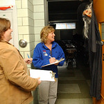 Kim McDonald, left, of Marco's Pizza, and Jennifer Stover, food services director for Midview Schools, judge a door for a decorating contest at Midview Middle School Oct. 28.   Steve Manheim ...