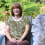 Chris Mumford, 61, of Lorain has been in remission from breast cancer for 4 1/2 years. She volunteers twice a week at the Cancer Center. Mumford is sitting in the garden at the center. One o ...