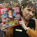 17NOV09  Her Hero--Logically.   Crewman Liz Denham of LaGrange, Ohio, holds up a Star Trek The Magazine issue with her hero Leonard Nimoy as the half-Vulcan, half Human 'logical' thinker and ...