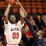 Elyria's Will Rudolph, left, shoots over Tevin Jones of Admiral King last night. DAVID RICHARD / CHRONICLE