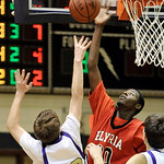 Elyria's Will Rudolph, right, blocks a shot attempt by Mitch Novak of Vermilion last night in the second half. DAVID RICHARD / CHRONICLE