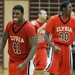 Elyria's Chase Farris, left, and Will Rudolph celebrate the Pioneers' victory in the Lorain  County Holiday Classic last night in Sandusky. DAVID RICHARD / CHRONICLE
