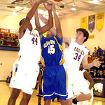 12-30-09 linda murphy  Avon's #44 Claude Gray & #34 Jordan Musser fight Clearview's #45 Aaron Arnozcky for the ball.