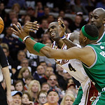 Cleveland Cavaliers' Antawn Jamison (5) passes away from Boston Celtics' Paul Pierce (34) and Kevin Garnett in the fourth quarter of Game 2 in the second round of the NBA basketball playoffs ...