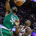 Boston Celtics' Rasheed Wallace (30) dunks on Cleveland Cavaliers' Antawn Jamison in the fourth quarter of Game 2 in the second round of an NBA basketball playoff series Monday, May 3, 2010, ...