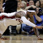 Cleveland Cavaliers' LeBron James loses the ball against Boston Celtics' Paul Pierce, left, in the third quarter of Game 2 in the second round of an NBA basketball playoff series Monday, May ...