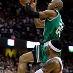Boston Celtics' Ray Allen (20) goes up for a shot against Cleveland Cavaliers' Mo Williams in the fourth quarter of Game 2 in the second round of an NBA basketball playoff series Monday, May ...