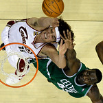 Cleveland Cavaliers' Anderson Varejao, from Brazil, and Boston Celtics' Kendrick Perkins (43) fight for a rebound in the second quarter of Game 2 in the second round of the NBA basketball pl ...