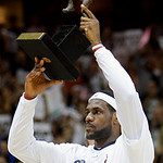 Cleveland Cavaliers' LeBron James holds the 2009-2010 MVP trophy during a presentation before Game 2 against the Boston Celtics in the second round of an NBA basketball playoff series Monday ...