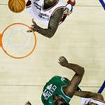 Cleveland Cavaliers' Shaquille O'Neal, top, goes in for a dunk against Boston Celtics' Kendrick Perkins (43) as Cavaliers' Antawn Jamison watches in the first quarter of Game 2 in the second ...