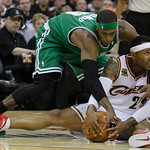 Boston Celtics' Rajon Rondo and Cleveland Cavaliers' Mo Williams (2) fight for possession in the fourth quarter of Game 2 in the second round of the  NBA basketball playoff  Monday, May 3, 2 ...