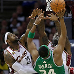 Cleveland Cavaliers' LeBron James (23) and Shaquille O'Neal defend a shot by Boston Celtics' Paul Pierce (34) in the third quarter of Game 2 in the second round of an NBA basketball playoffs ...