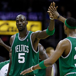 Boston Celtics' Kevin Garnett (5) congratulates Paul Pierce in the fourth quarter of Game 2 against the Cleveland Cavaliers in the second round of the  NBA basketball playoffs Monday, May 3, ...