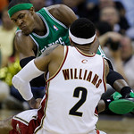 Boston Celtics' Rajon Rondo fights for a oose  ball with Cleveland Cavaliers' Mo Williams (2) in the fourth quarter of Game 2 in the second round of an NBA basketball playoff series Monday,  ...