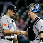 Toronto Blue Jays relief pitcher Kevin Gregg, left, is congratulated by catcher John Buck after Gregg got the save in an 8-5 win over the Cleveland Indians in a baseball game Tuesday, May 4, ...