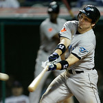 Toronto Blue Jays' Travis Snider doubles off Cleveland Indians relief pitcher Jamey Wright to drive in a run in the fifth inning of a baseball game Tuesday, May 4, 2010, in Cleveland. (AP Ph ...