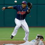 Cleveland Indians shortstop Luis Valbuena leaps to catch a high throw as Toronto Blue Jays' Travis Snider steals second base in the second inning of a baseball game Tuesday, May 4, 2010, in  ...