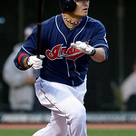 Cleveland Indians' Shin-Soo Choo, from South Korea, singles off Toronto Blue Jays starting pitcher Ricky Romero to drive in two runs in the third inning of a baseball game Tuesday, May 4, 20 ...