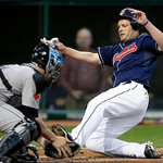 Cleveland Indians' Austin Kearns slides home past Toronto Blue Jays catcher John Buck to score in the third inning of a baseball game Tuesday, May 4, 2010, in Cleveland. (AP Photo/Mark Dunca ...