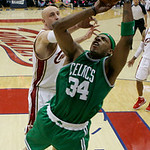 Boston Celtics' Paul Pierce (34) gets inside Cleveland Cavaliers' Zydrunas Ilgauskas, from Lithuania, for a shot in he second quarter of Game 5 of a second round NBA basketball playoff serie ...