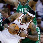 Cleveland Cavaliers' LeBron James, front, is fouled by Boston Celtics' Glen Davis on a rebound in the second quarter of Game 5 of a second round NBA basketball playoff series Tuesday, May 11 ...