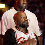 Raymond Towler, front, stands for the national anthem with Cleveland Cavaliers' Shaquille O'Neal before Game 5 against the Boston Celtics in a second round NBA basketball playoff series Tues ...
