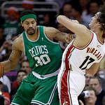 Boston Celtics' Rasheed Wallace (30) commits an offensive foul against Cleveland Cavaliers' Anderson Varejao (17), from Brazil, in the first quatrer of Game 5 of a second round NBA basketbal ...