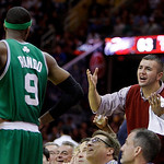 Cleveland Cavaliers fan Noeno Iftiu yells at Boston Celtics' Rajon Rondo (9) in the third quarter of Game 5 of a second round NBA basketball playoff series Tuesday, May 11, 2010, in Clevelan ...