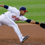 Cleveland Indians third baseman Jhonny Peralta can't reach a single by Chicago White Sox's Gordon Beckham in the second inning of a baseball game Monday, May 24, 2010, in Cleveland. (AP Phot ...