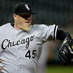 Chicago White Sox relief pitcher Bobby Jenks takes the throw from first baseman Paul Konerko to get Cleveland Indians' Austin Kearns at first for the final out in a baseball game Monday, May ...