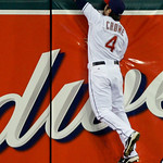 Cleveland Indians center fielder Trevor Crowe hits the wall chasing a double by Chicago White Sox's Andruw Jones in the ninth inning of a baseball game Monday, May 24, 2010, in Cleveland. Th ...