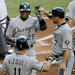 Chicago White Sox's Andruw Jones (25) is greeted by Mark Kotsay (7) after both scored on a double by Mark Teahen in the first inning of a baseball game against the Cleveland Indians on Monda ...