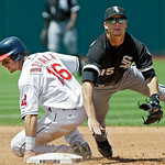 Chicago White Sox second baseman Gordon Beckham (15) tumbles over Cleveland Indians' Jason Donald (16) after a force at second in the fifth inning of a baseball game Wednesday, May 26, 2010, ...