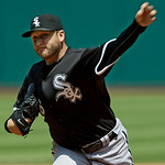 Chicago White Sox's Mark Buehrle pitches against the Cleveland Indians in the first inning of a baseball game Wednesday, May 26, 2010, in Cleveland. (AP Photo/Mark Duncan)