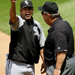 Chicago White Sox manager Ozzie Guillen, left, argues with umpire Joe West after Guillen was ejected from a baseball game against the Cleveland Indians in the second inning Wednesday, May 26 ...