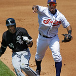 Cleveland Indians second baseman Luis Valbuena, right, chases Chicago White Sox's Alexei Ramirez in a rundown between first and second in the third inning of a baseball game Wednesday, May 2 ...