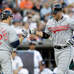 Cleveland Indians' Russell Branyan, center, is congratulated on his solo home run by Mark Grudzielanek, left, as Detroit Tigers catcher Gerald Laird, right, looks on in the fifth inning of a ...