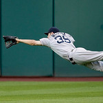 Boston Red Sox center fielder Josh Reddick dives unsuccessfully for a triple hit by Cleveland Indians' Trevor Crowe in the third inning in a baseball game, Wednesday, June 9, 2010, in Clevel ...