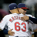 Cleveland Indians manager Manny Acta, right, hugs pitcher Justin Masterson after they defeated the Boston Red Sox 11-0 in a baseball game, Wednesday, June 9, 2010, in Cleveland. (AP Photo/To ...