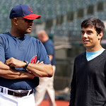 Cleveland Indians first base coach Sandy Alomar, left, talks with the team's eighth-round draft pick, Alex Lavisky, before the Indians played the Boston Red Sox in a baseball game Wednesday, ...