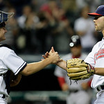 Cleveland Indians pitcher Justin Masterson, right, is congratulated by catcher Lou Marson after they defeated the Boston Red Sox 11-0 in a baseball game on Wednesday, June 9, 2010, in Clevel ...