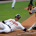 Cleveland Indians' Trevor Crowe, left, tags home plate and scores as Boston Red Sox catcher Victor Martinez is late on the tag in the first inning in a baseball game on Wednesday, June 9, 20 ...