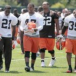 Cleveland Browns running back James Davis (21), fullback Lawrence Vickers (47), and running back Jerome Harrison (35) walk off the field together after the morning session of the the team's  ...