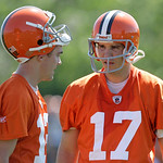 Cleveland Browns quarterbacks Jake Delhomme, right, and Colt McCoy talk at the team's NFL football minicamp in Berea, Ohio on Thursday, June 10, 2010. (AP Photo/Amy Sancetta)