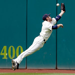 Cleveland Indians center fielder Trevor Crowe leaps but misses a two-run triple to center by Washington Nationals' Ian Desmond during the sixth inning of a baseball game in Cleveland on Sund ...