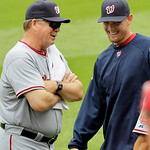 Washington Nationals starting pitcher Stephen Strasburg, right, shares a laugh with pitching coach Steve McCatty, left, before taking the mound against the Cleveland Indians in a baseball ga ...