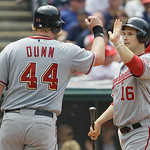 Washington Nationals' Adam Dunn (44) is high-fived by teammate Josh Wilmingham after Dunn and Ryan Zimmerman scored on a  two-run double by Ivan Rodriguez in the sixth inning of a baseball g ...