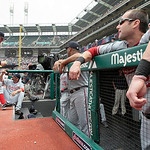 Washington Nationals starting pitcher Stephen Strasburg, second from left, heads into the team dugout before his start against the Cleveland Indians in a baseball game in Cleveland on Sunday ...