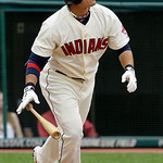 Cleveland Indians batter Shin-Soo Choo watches the flight of his two-run, bases-loaded single in the ninth inning against Washington Nationals pitcher Miguel Batista in a baseball game in Cl ...
