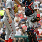 Washington Nationals catcher Ivan Rodriguez, right, pats starting pitcher Stephen Strasburg on the back of the head during a meeting on the mound during the fourth inning of a baseball game  ...